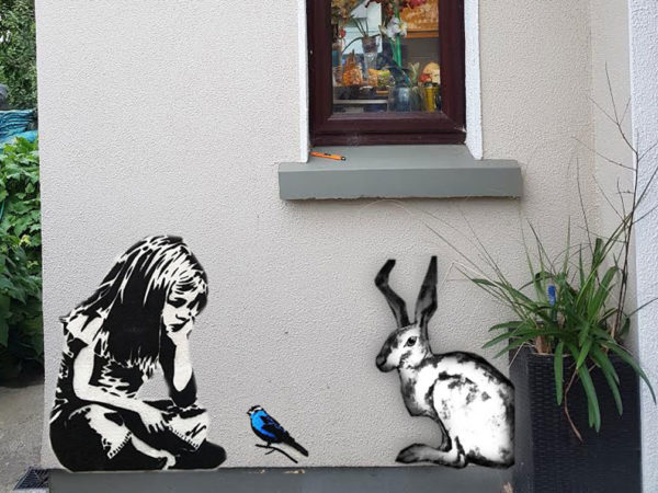 Wall art Small girl with bird and hare